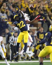 David Long breaks up a pass intended for Wisconsin receiver A.J. Taylor last season.