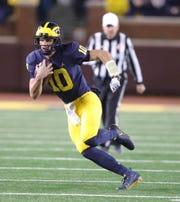 Michigan quarterback Dylan McCaffrey runs for a touchdown against Wisconsin during the second half Saturday, Oct. 13, 2018 at Michigan Stadium in Ann Arbor.