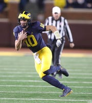 Michigan quarterback Dylan McCaffrey runs for a touchdown against Wisconsin during the second half Saturday, Oct. 13, 2018 at Michigan Stadium in Ann Arbor.