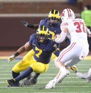 Michigan's Khaleke Hudson tries to tackle Wisconsin's Garrett Groshek on Saturday, Oct. 13, 2018 at Michigan Stadium in Ann Arbor.