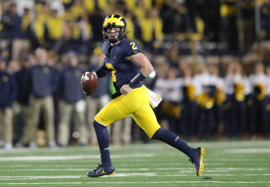 Michigan quarterback Shea Patterson looks to pass during the first half against Wisconsin, Saturday, Oct. 13, 2018 at Michigan Stadium in Ann Arbor.