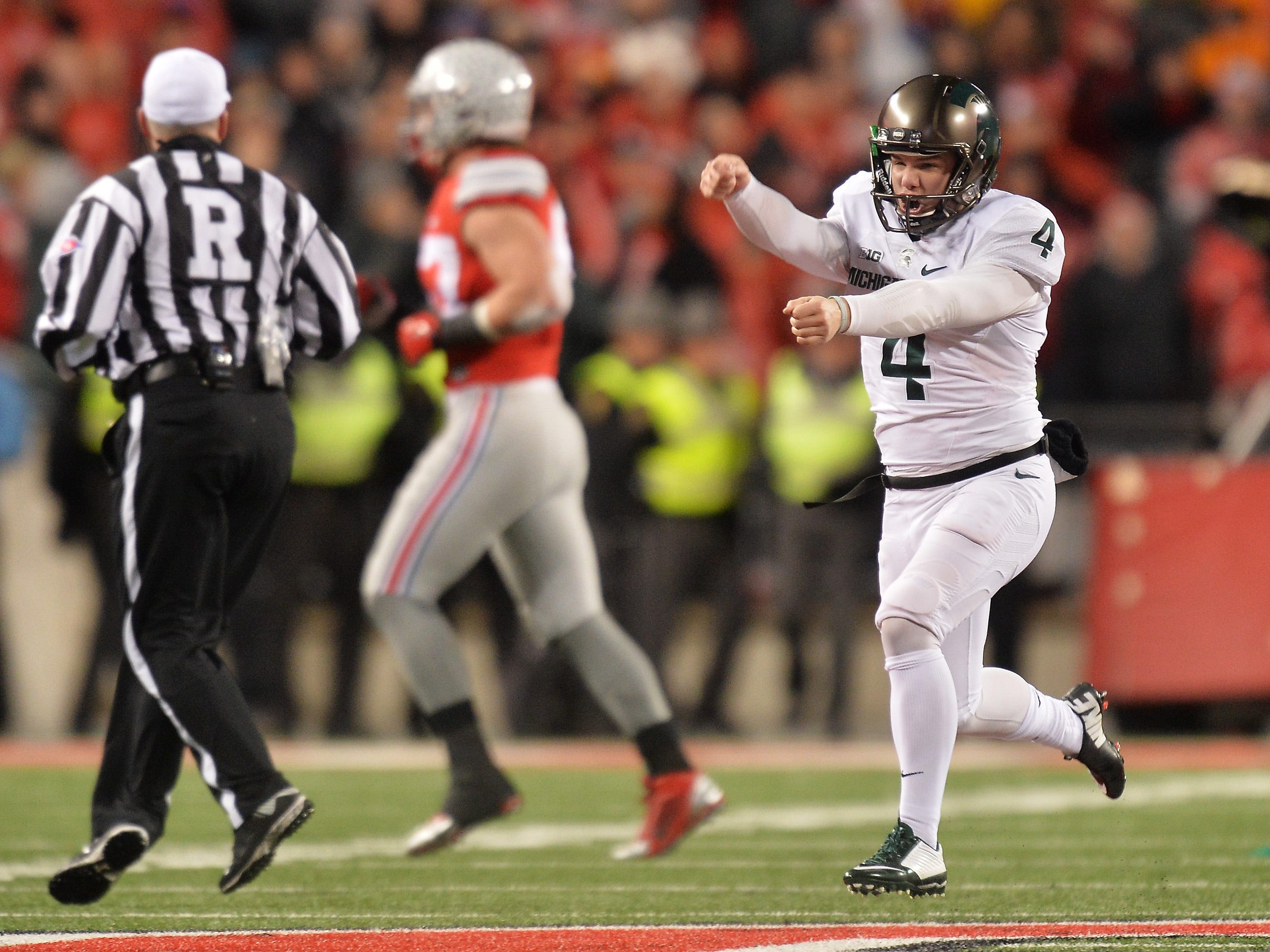 Nov. 21, 2015: No. 9 Michigan State 17, No. 2 Ohio State 14: Kicker Michael runs up the field celebrating after kicking a 41-yard field goal as time expired to stun the Buckeyes.