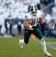 Michigan State's Matt Sokol takes off with a catch against Penn State.