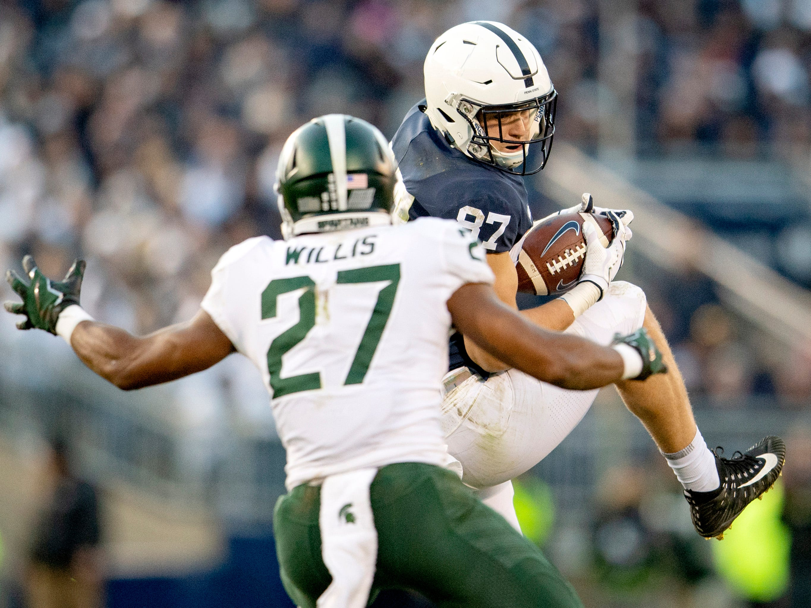 Penn State tight end Pat Freiermuth (87) makes a catch against Michigan State safety Khari Willis (27) at Beaver Stadium in University Park, Pa., on Saturday, Oct. 13, 2018. The visiting Spartans won, 21-17. (Abby Drey/Centre Daily Times/TNS)