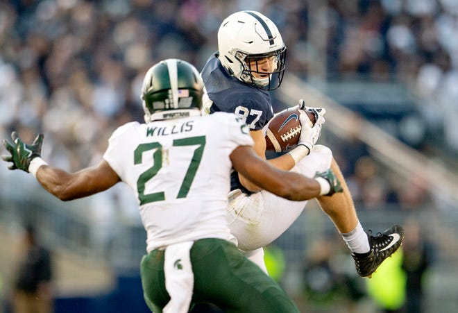 Penn State tight end Pat Freiermuth (87) makes a catch against Michigan State safety Khari Willis on Saturday.
