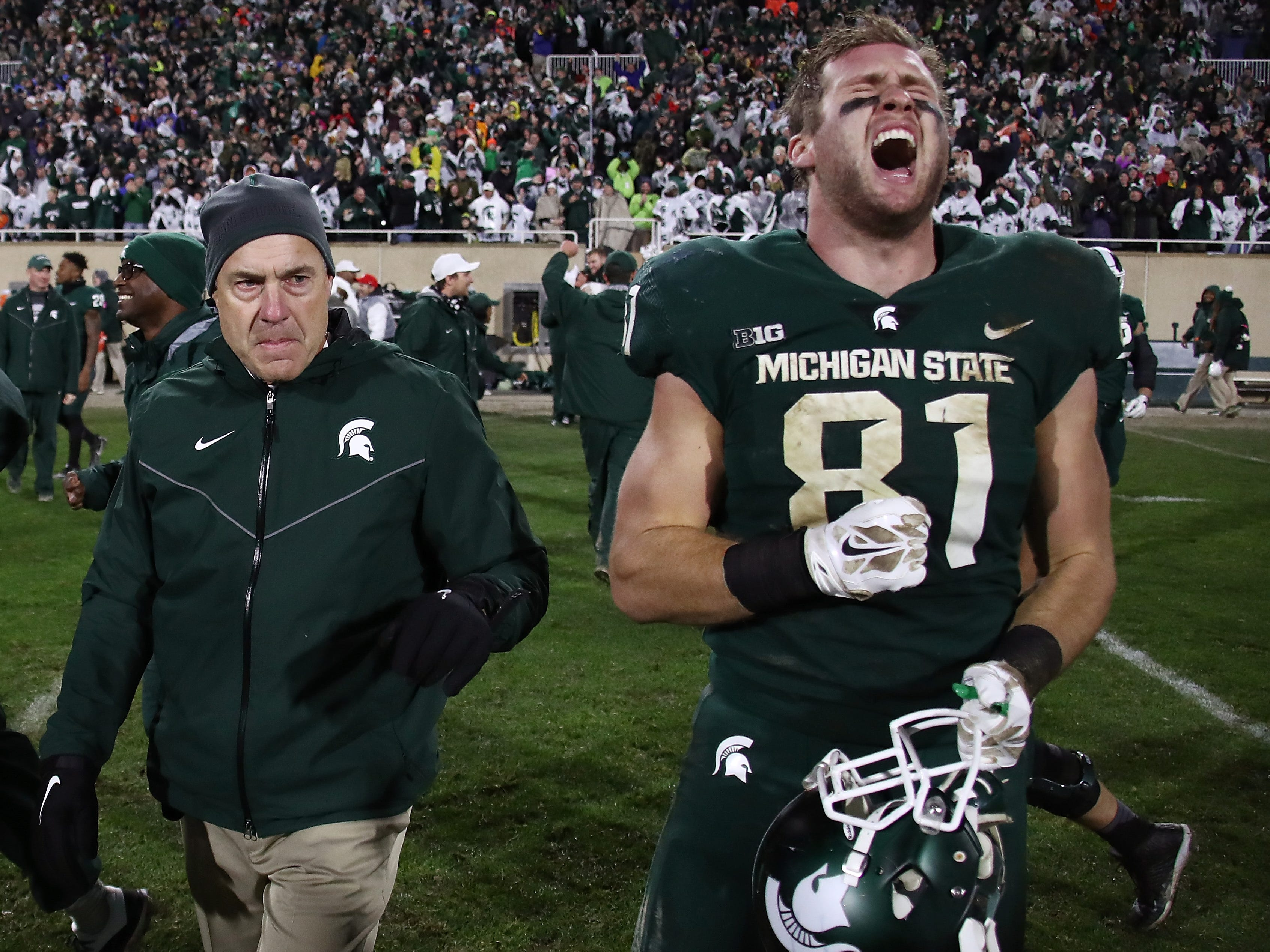Nov. 4, 2017: No. 24 Michigan State 27, No. 7 Penn State 24: Matt Sokol celebrates the victory, played in terrible weather, as Mark Dantonio walks by.