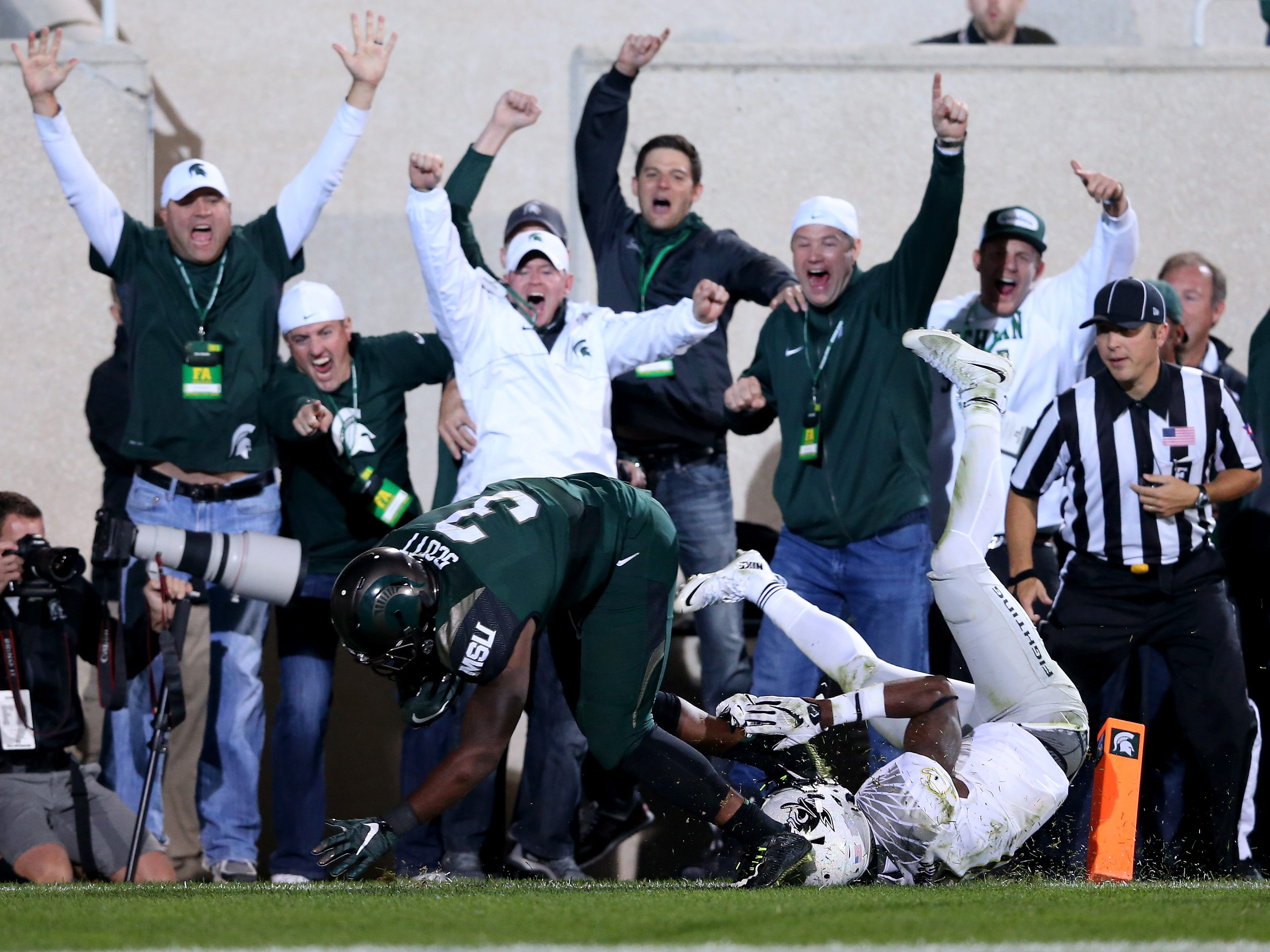 Sept. 12, 2015: No. 5 Michigan State 31, No. 7 Oregon 28: LJ Scott scores a touchdown, to the delight of the fans.