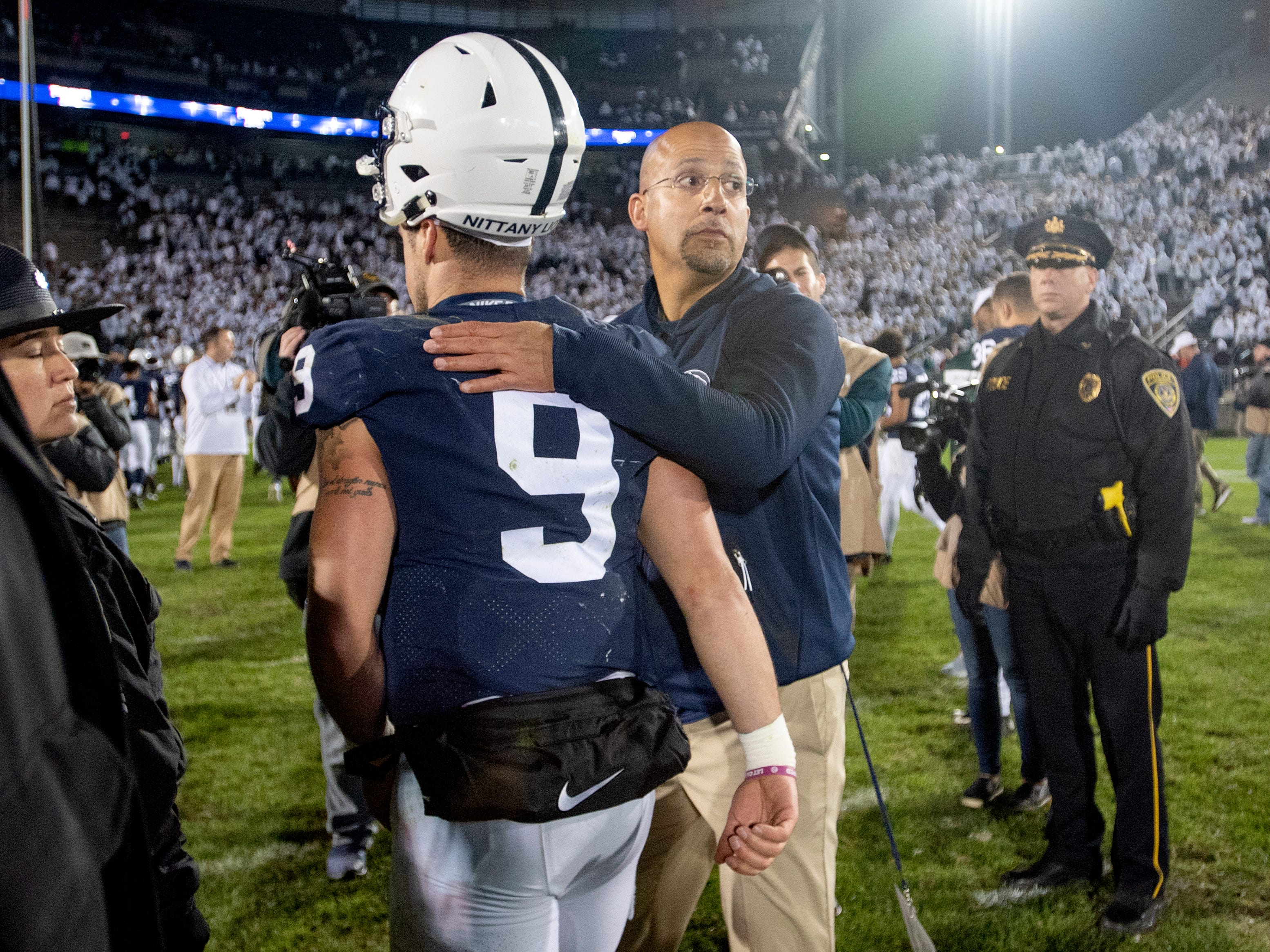 Penn State football coach James Franklin pats quarterback Trace McSorley (9) on the back as they walk off the field after a loss to Michigan State in an NCAA college football game Saturday, Oct. 13, 2018, in State College, Pa. (Abby Drey/Centre Daily Times via AP)