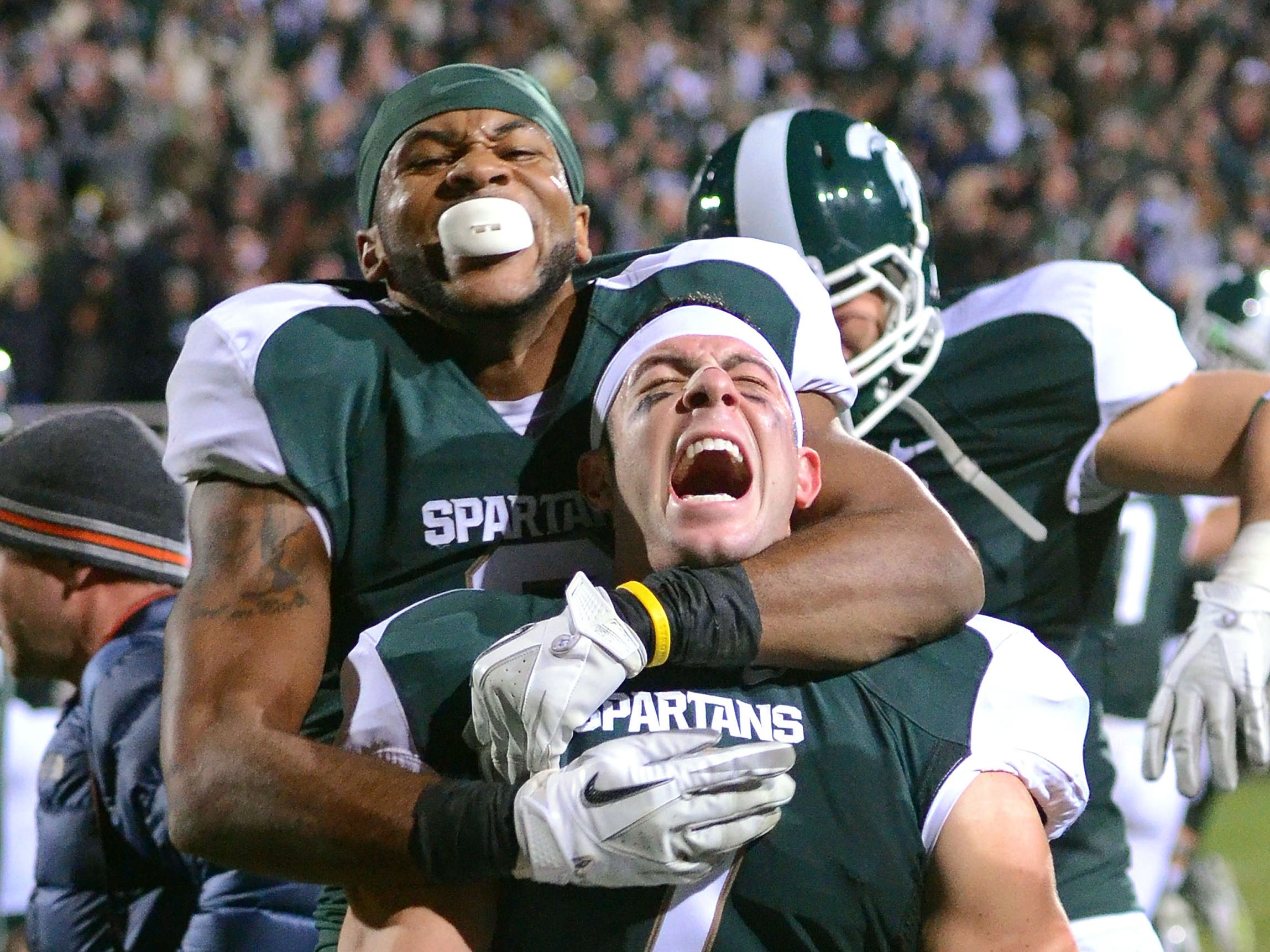 Oct. 22, 2011: No. 15 Michigan State 37, No. 4 Wisconsin 31: B.J. Cunningham and Keith Nichol (7) celebrate.