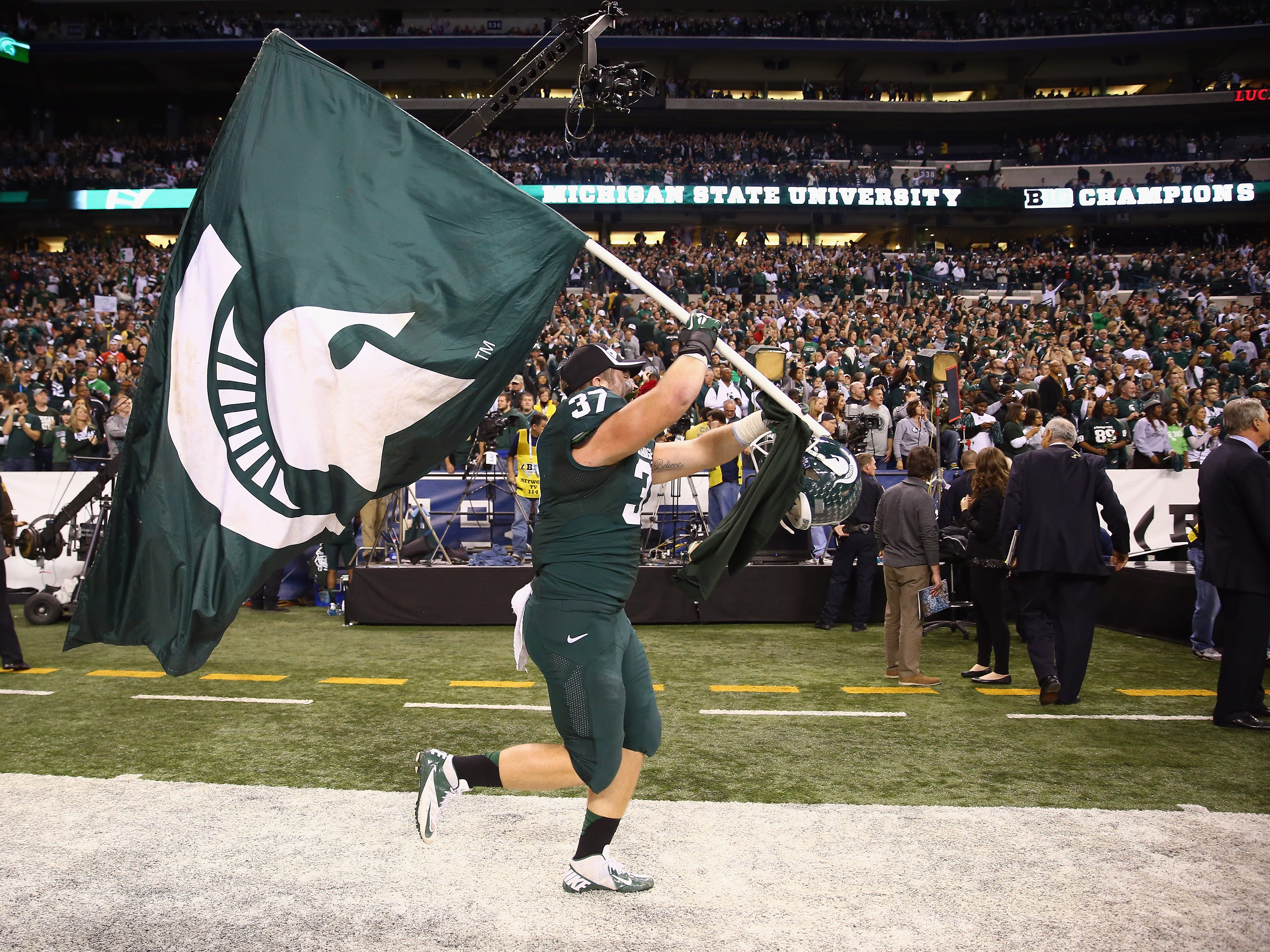 Dec. 7, 2013: No. 10 Michigan State 34, No. 2 Ohio State 24 (Big Ten championship game): Trevon Pendleton celebrates with the flag.