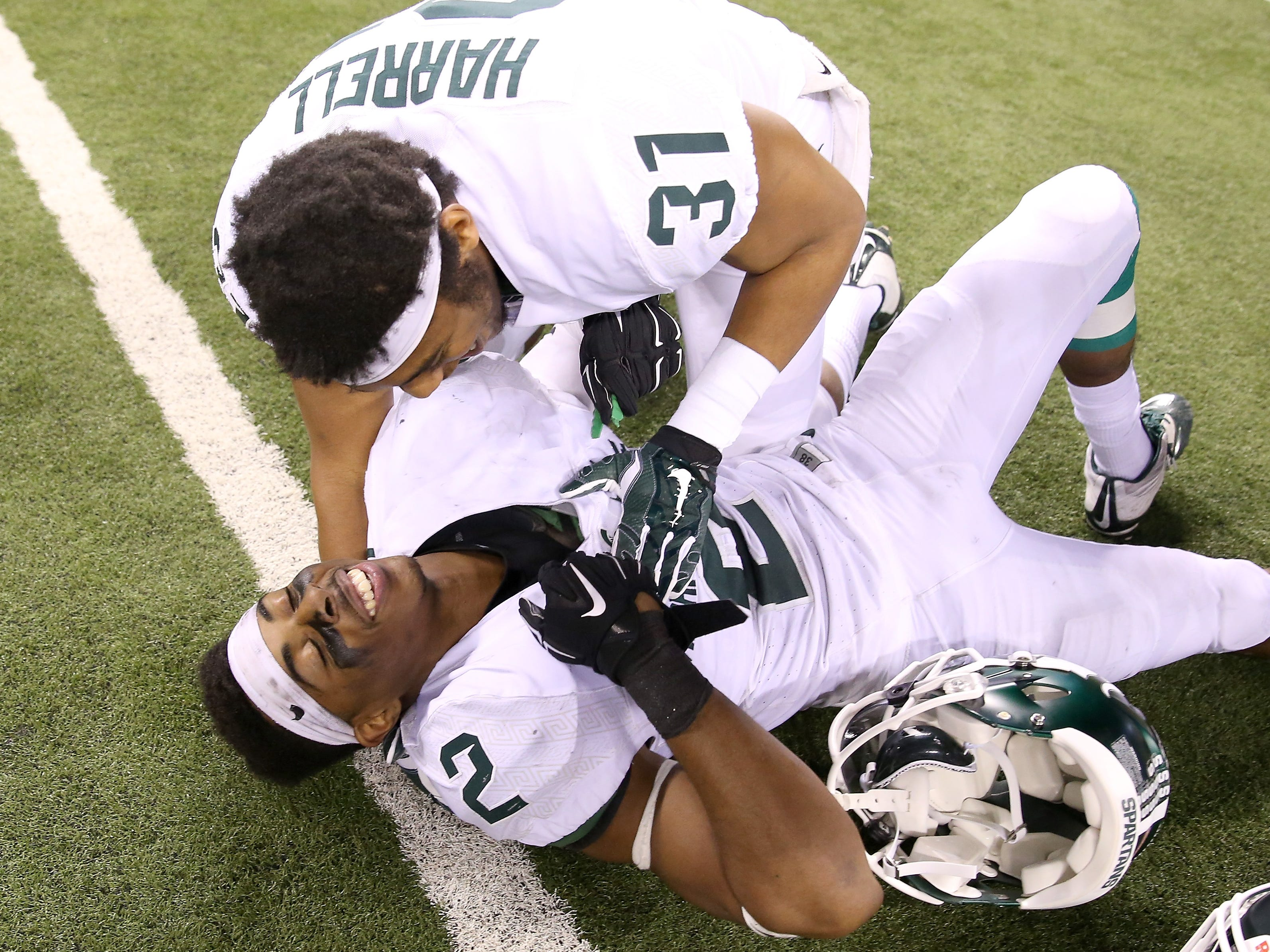 Dec. 5, 2015: No. 5 Michigan State 16, No. 4 Iowa 13 (Big Ten championship game): Darian Hicks (2) and T.J. Harrell celebrate the victory that earned the Spartans a spot in the College Football Playoffs.