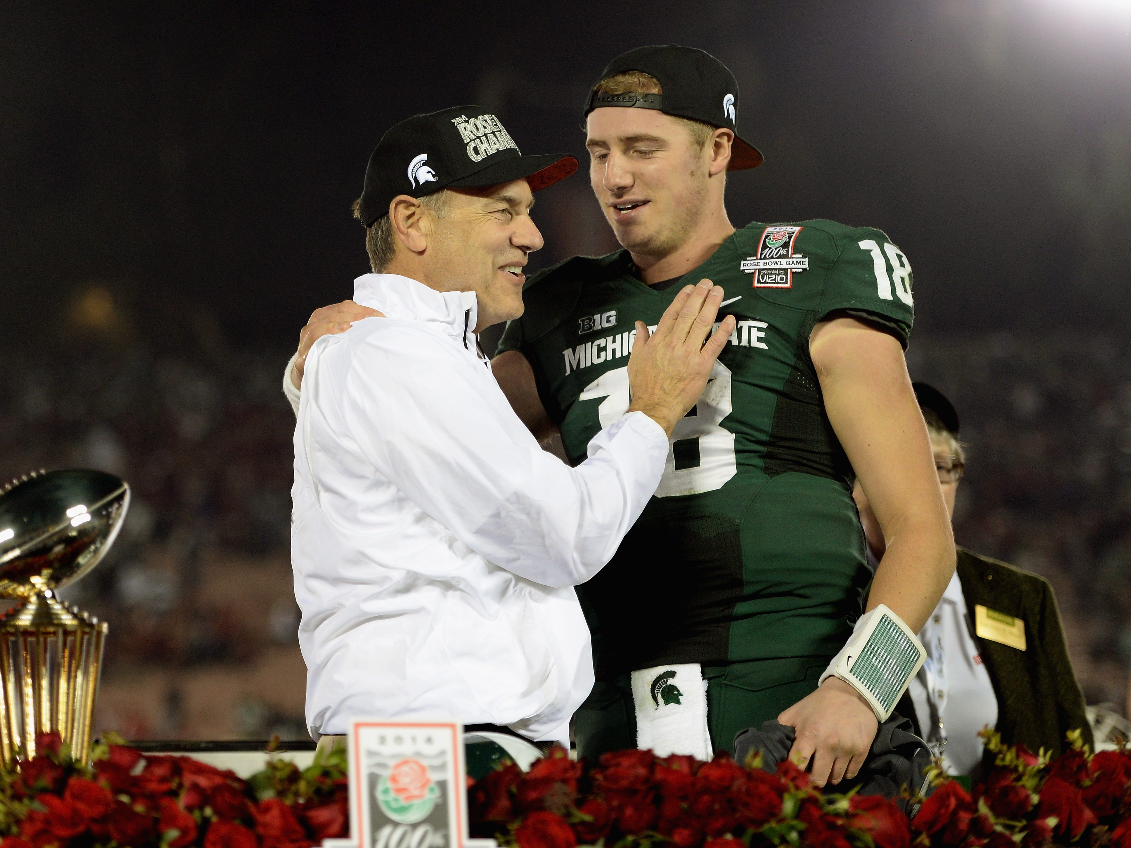 Jan. 1, 2014: No. 4 Michigan State 24, No. 5 Stanford 20 (Rose Bowl): Michigan State coach Mark Dantonio celebrates with quarterback Connor Cook after the victory,