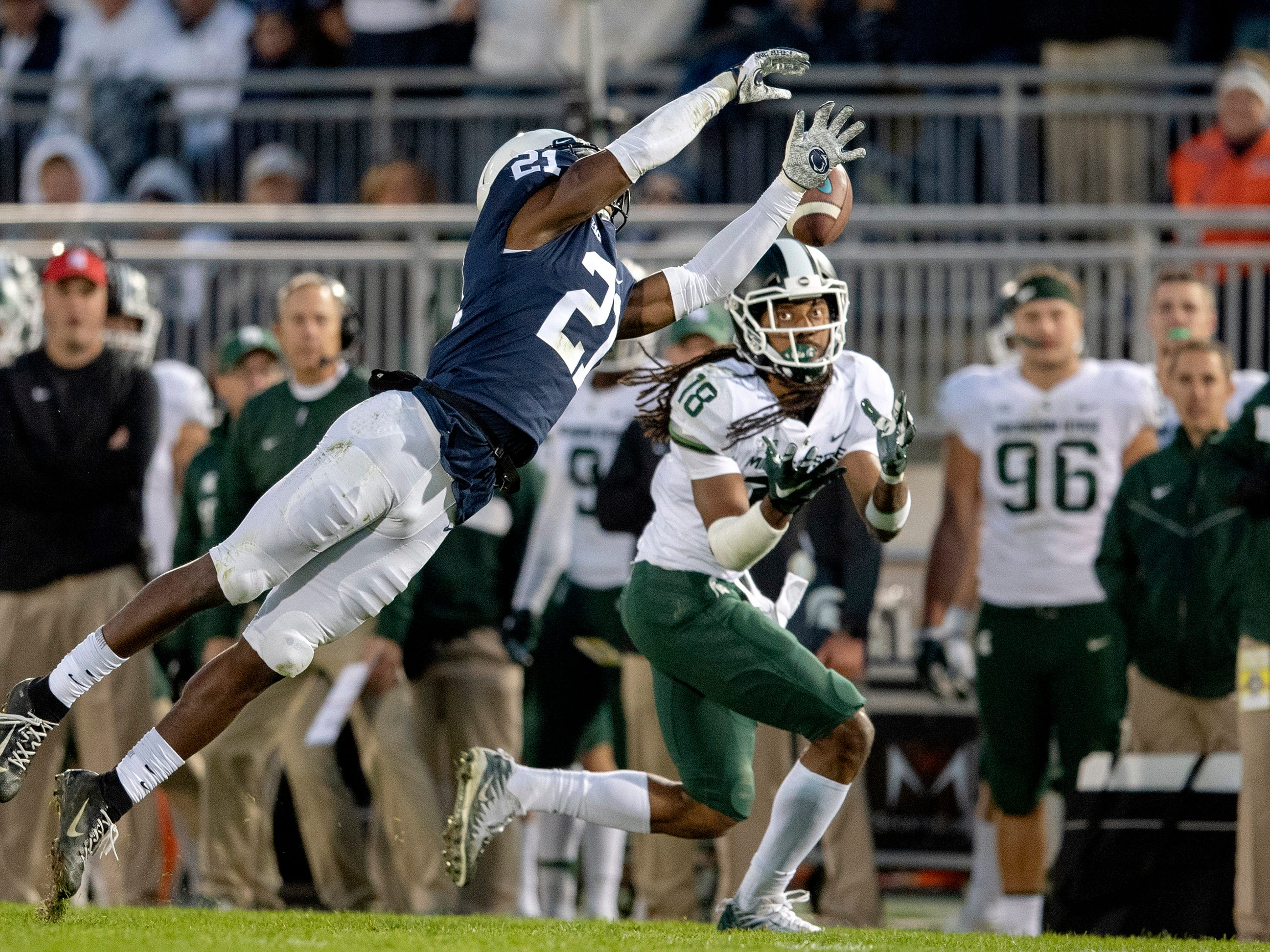 Penn State cornerback Amani Oruwariye can't stop the game-winning 25-yard touchdown pass to Michigan State wide receiver Felton Davis III, right, in the fourth quarter at Beaver Stadium in University Park, Pa., on Saturday, Oct. 13, 2018. The visiting Spartans won, 21-17. (Abby Drey/Centre Daily Times/TNS)