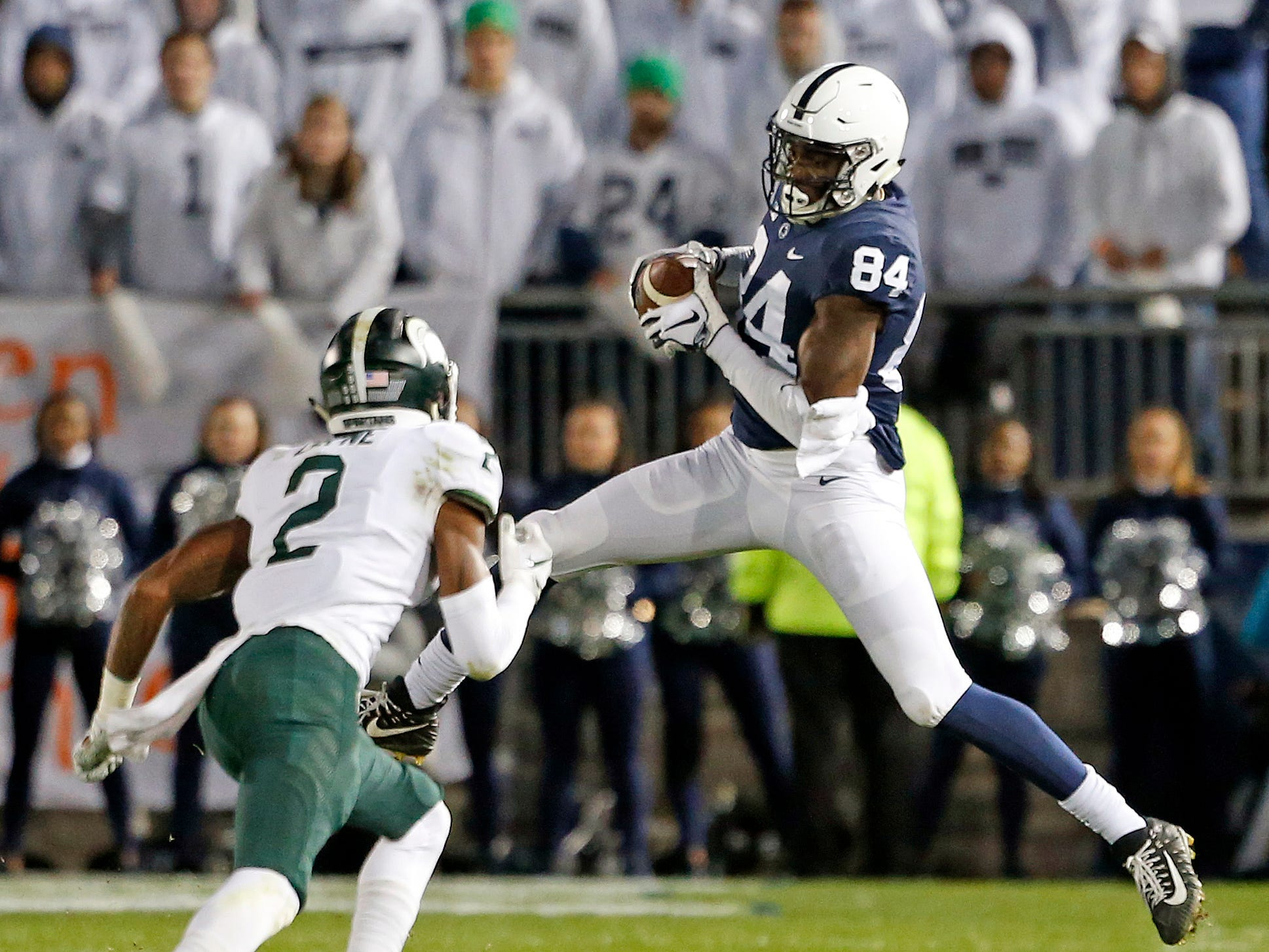 Penn State's Juwan Johnson (84) catches a pass in front of Michigan State's Justin Layne (2) during the second half of an NCAA college football game in State College, Pa., Saturday, Oct. 13, 2018. (AP Photo/Chris Knight)