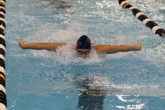Summer Pierce of Owego swims to first place in the 100-yard butterfly at the Dr. Jack Thomas Invitational at Ernie Davis Academy on Oct. 13, 2018.