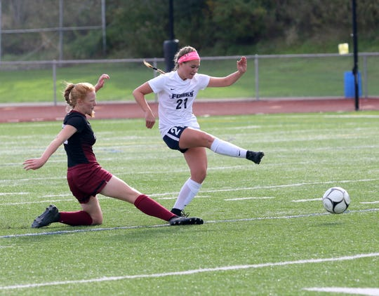 Sophie Rusnak of Chenango Forks kicks the ball ahead as Caylee Boorse of slides in during a STAC girls soccer semifinal Oct. 13, 2018 at Ernie Davis Academy.