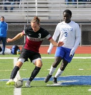 Luke Baldwin of Elmira controls the b all in front of Hastings Otieno of Oneonta during a STAC boys soccer semifinal in October at Ernie Davis Academy.