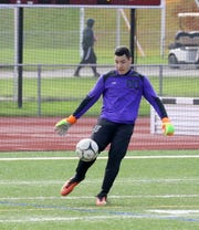Elmira goalie Nate Burrows kicks the ball deep during a 2-0 win over Oneonta on Oct. 13, 2018 in a STAC boys soccer semifinal at Ernie Davis Academy.