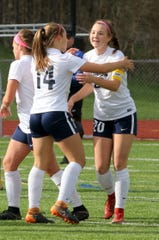 Emma Bough, right, is congratulated by teammate Lexi Bartlow after scoring the first goal in a 5-0 win over Elmira on Oct. 13, 2018 in a STAC girls soccer semifinal at Ernie Davis Academy.
