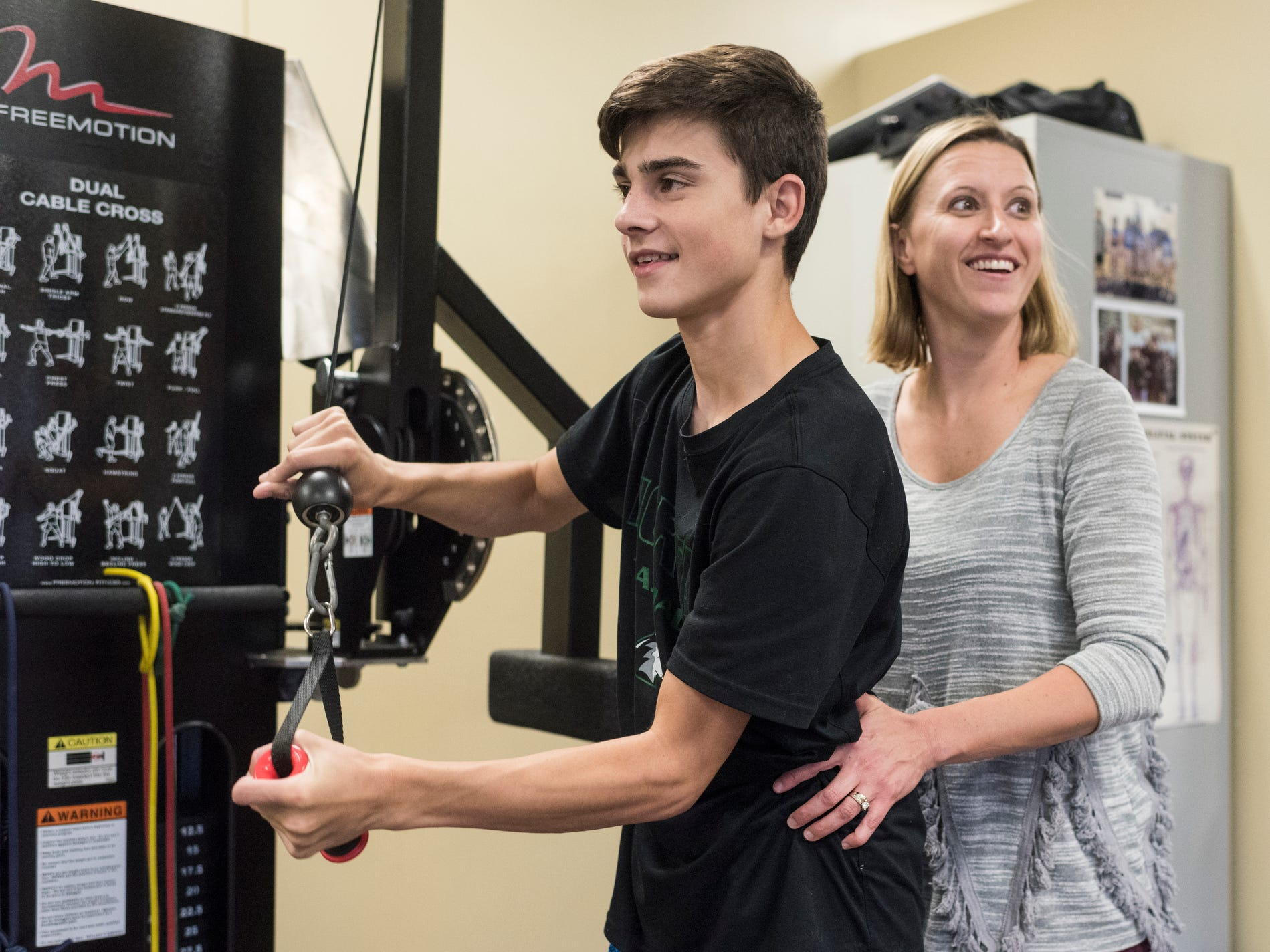 Sam Archuleta, left, attends physical therapy appointments with Natalie Hussmann, right, once a week at Pro Rehab, located along N. First Avenue, in Evansville, Ind. They work on his balance and strength to combat the effects of his rare degenerative neuromuscular disorder called Friedreich's ataxia (FA).