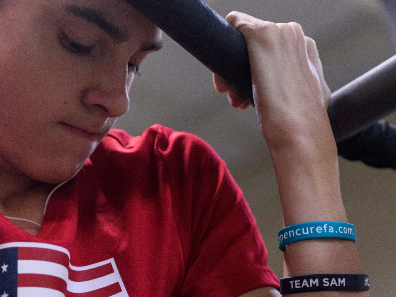 Sam Archuleta sports armbands that he will be selling to raise money for the Friedreich's Ataxia Research Alliance foundation, which aims to find a cure for his rare degenerative neuromuscular disorder.