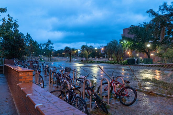Florida State campus aftermath featured downed trees and debris. University closure affected numerous local events.