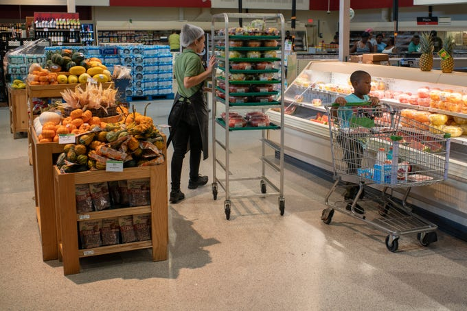 Residents and students at Publix on Ocala Rd. prepare for extended power outages following Michael's impact