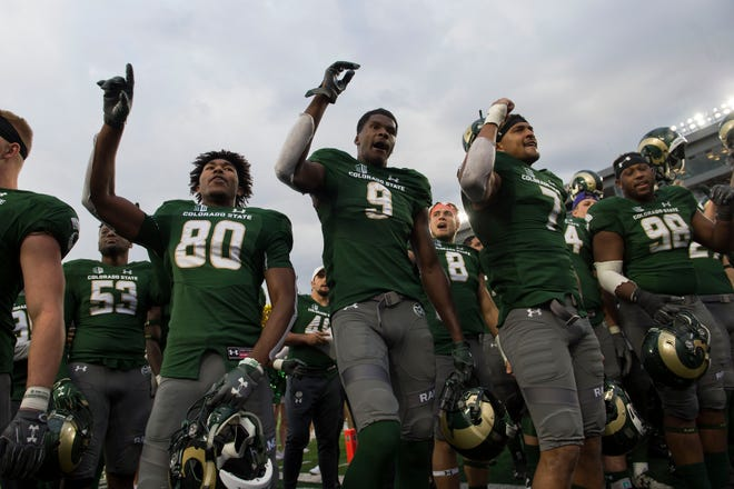 Receivers Nikko Hall, Warren Jackson and other CSU football players sing the school's fight song after rallying for a 30-28 homecoming victory last Saturday over New Mexico at Canvas Stadium. With the win, the Rams (3-4, 2-1 Mountain West) moved within three victories of bowl-eligibility with five games remaining in the regular season.