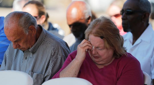 Sheri McKeand wipes away her tears during an emotional service Sunday morning in the aftermath of Hurricane Michael. Members of The Church of Christ at Jenks avenue in Panama City, Florida, held the outdoor service October 14, 2018, as their main congregation building had suffered significant roof damage.