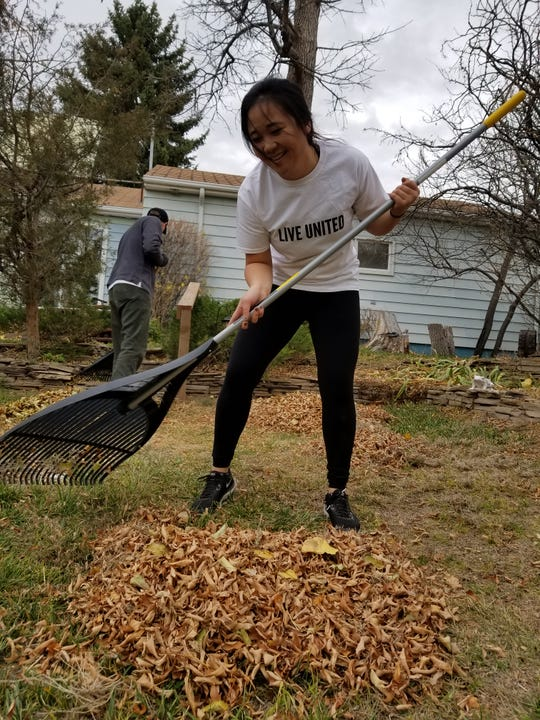 Kim Jones, a student at University of Providence, helps out during the United Way Day of Caring, doing yard work for the elderly and disabled in the community.