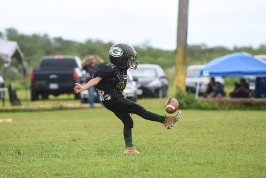 In this Oct. 14, 2018, file photo, the Guam Packers' Kaden Lee Medler punts during a Guam National Youth Football Federation Manha division playoff game at Eagles Field in Mangilao.