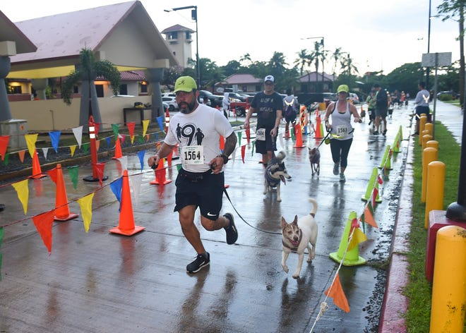 "Owners complete the 2K race with their pets during Guam Animals In Need's second annual 5K and 2K Doggy Dash ""2 Fast 2 Furriest"" at in Hagåtña, Oct. 14, 2018."
