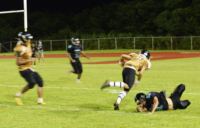 JFK Islanders wideout No. 4 Nico Velez turns upfield after catching a pass from quarterback Andrew Perez. Southern High Dolphins safety Gabe Stanley saved the defense by pushing Velez out of bounds with inches to go.