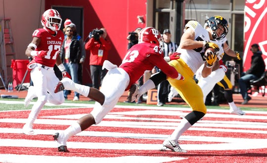 Iowa Hawkeyes tight end T.J. Hockenson (38) catches a pass in the end zone for a touchdown against Indiana Hoosiers linebacker Dameon Willis Jr. (43) during the first quarter at Memorial Stadium .