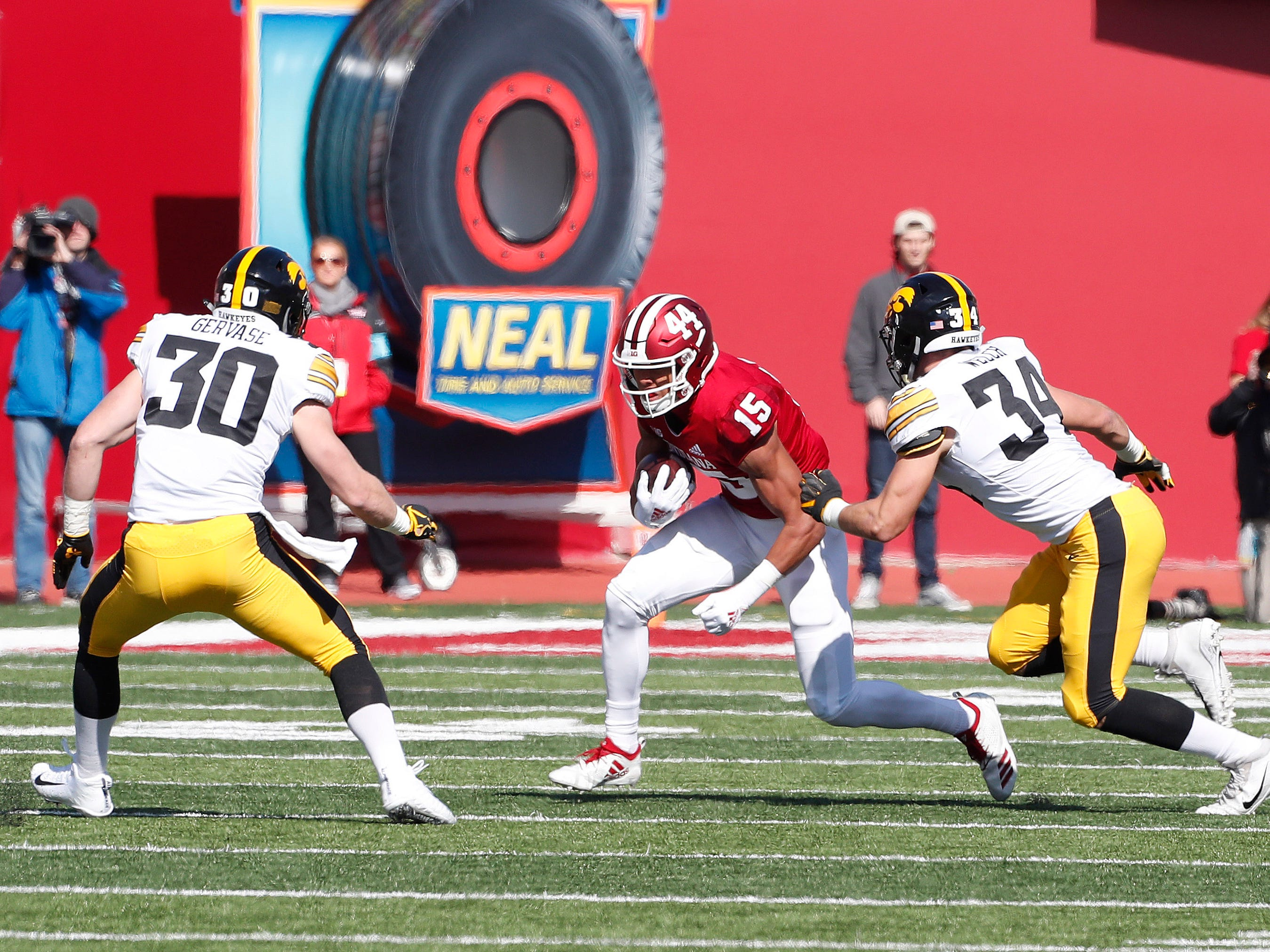 Indiana Hoosiers wide receiver Nick Westbrook (15) runs with the ball after making a catch against  Iowa Hawkeyes defensive back Jake Gervase (30) during the first quarter at Memorial Stadium.