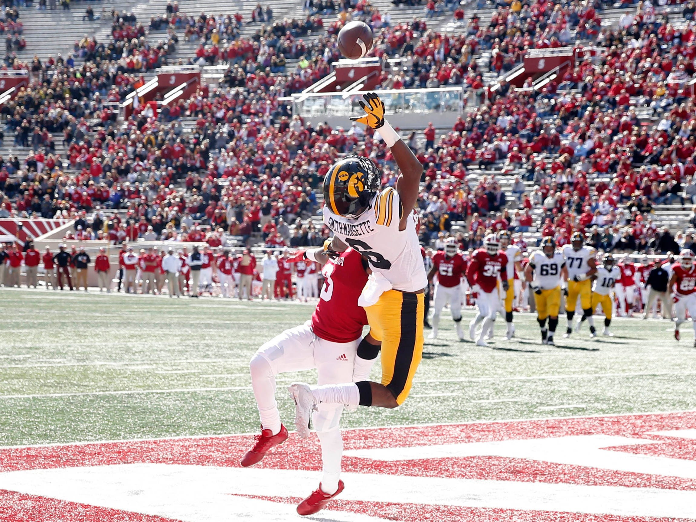 Iowa Hawkeyes wide receiver Ihmir Smith-Marsette (6) can not come up with a catch against Indiana Hoosiers defensive back Jonathan Crawford (9) during the fourth quarter at Memorial Stadium.