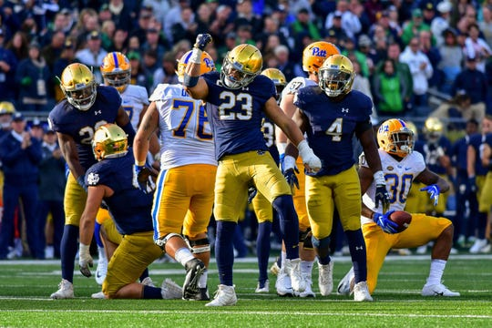 Fighting Irish linebacker Drue Tranquill (23) celebrates after a tackle in the fourth quarter against the Pittsburgh Panthers at Notre Dame Stadium.