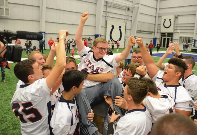 Bedford North Lawrence players lift their teammate Jesse Lane in celebration of their championship victory against Tippecanoe Valley at the Inaugural Unified Flag Football State Finals at the Colts Training Complex in Indianapolis, Ind., Saturday, Oct. 13, 2018. Bedford North Lawrence defeated Tippecanoe Valley 50-26 for the state title.