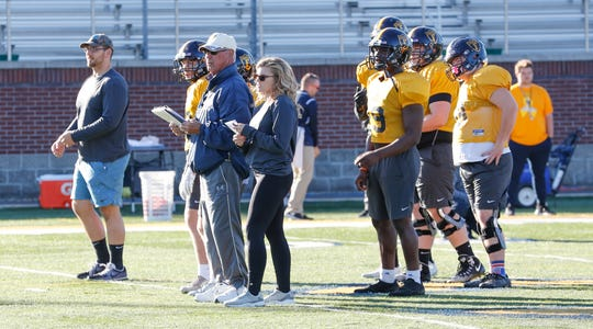 Nelson carries out her coaching duties during practice at Franklin College. Next year, she hopes to play on the football team.  (Michelle Pemberton/IndyStar)