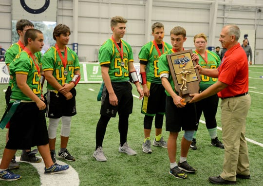 Tippecanoe Valley accepts the runner-up trophy after falling to Bedford North Lawrence at the Inaugural Unified Flag Football State Finals at the Colts Training Complex in Indianapolis, Ind., Saturday, Oct. 13, 2018. Bedford North Lawrence defeated Tippecanoe Valley 50-26 for the state title.
