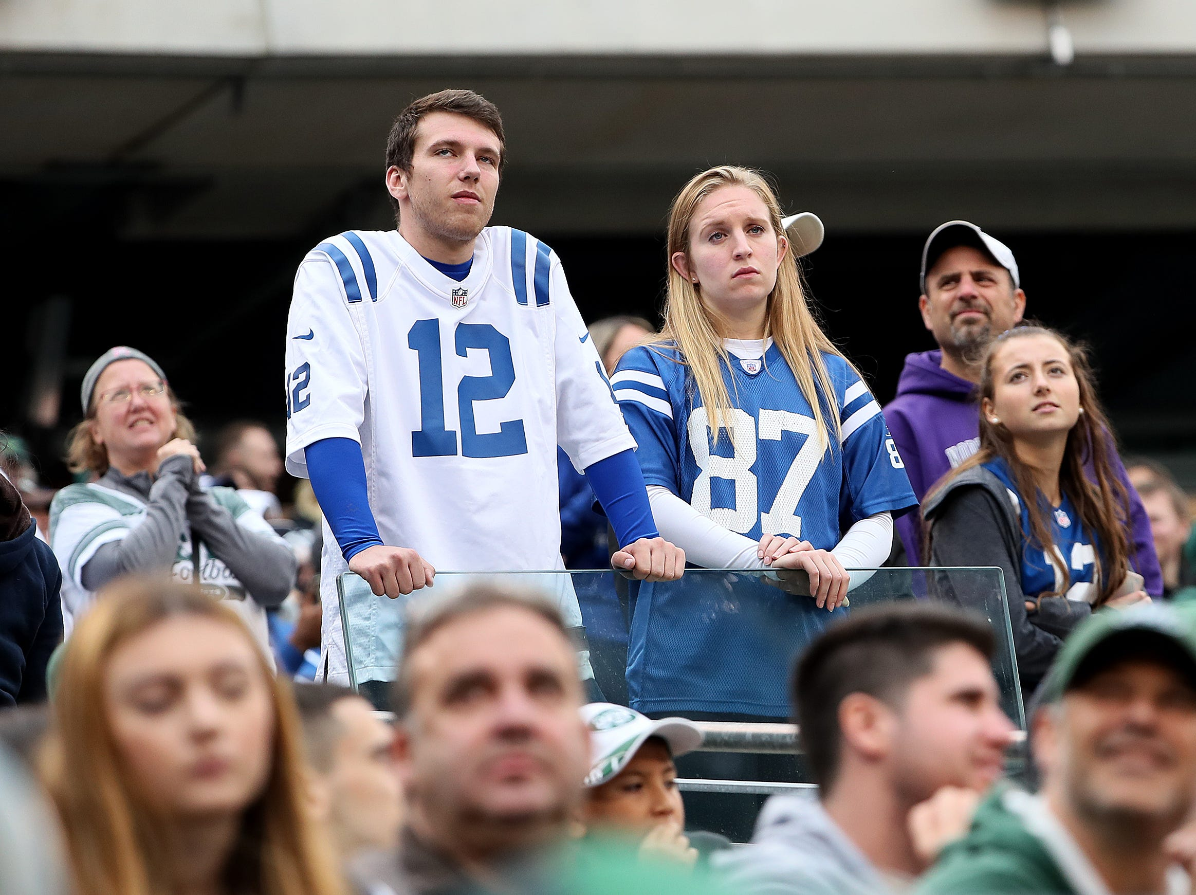 Dejected Indianapolis Colts fans look on in the fourth quarter of their game against the New York Jets at MetLife Stadium in East Rutherford, N.J., Sunday, Oct. 14, 2018.