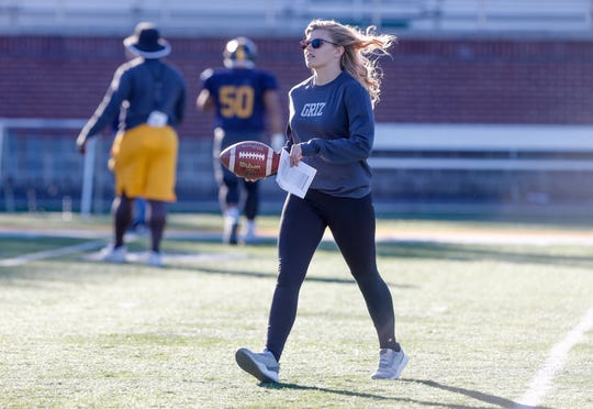Hope Nelson, a freshman student football coach at Franklin College, and a former football player on the mens team at Indian Creek High School, carries out her coaching duties during practice at Franklin College on Thursday, October 11, 2018. Nelson, who suffered a childhood eye injury hasn't been held back by blindness in one eye, playing high school football on the mens team as a  defensive back, cheerleading, pole vaulting, and taking years of dance. Nelson plans to try out for the mens team at Franklin in the spring.