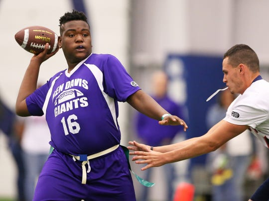 Ben Davis' Keenan Cash gets the ball out of the pocket in time against Bedford North Lawrence defense during the semi-final game of the Inaugural Unified Flag Football State Finals at the Colts Training Complex in Indianapolis, Ind., Saturday, Oct. 13, 2018. Tippecanoe Valley and Bedford North Lawrence advanced in the semi-finals to play in the finals.