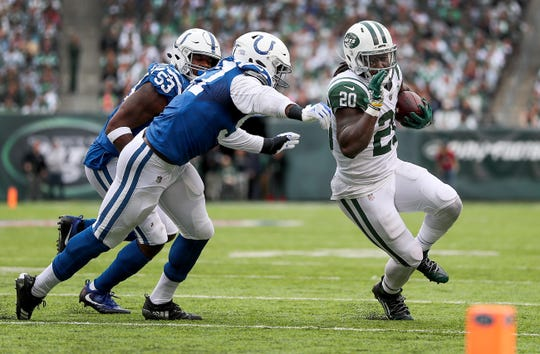 Indianapolis Colts defensive tackle Hassan Ridgeway (91) forces New York Jets running back Isaiah Crowell (20) out of bounds  in the second quarter of their game against the New York Jets at MetLife Stadium in East Rutherford, N.J., Sunday, Oct. 14, 2018.