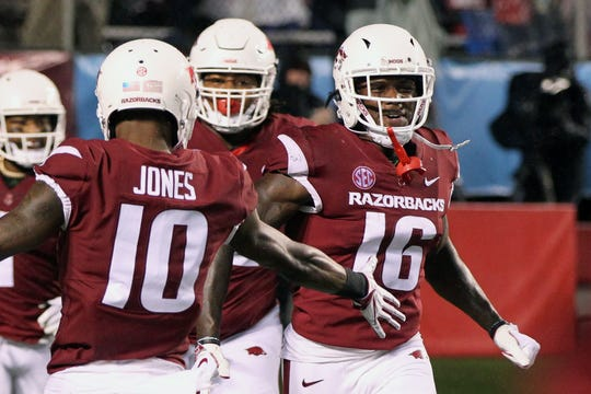 Arkansas Razorbacks wide receiver La'Michael Pettway (16) celebrates after scoring a touchdown in the second quarter against the Ole Miss Rebels at War Memorial Stadium in Little Rock, Arkansas.