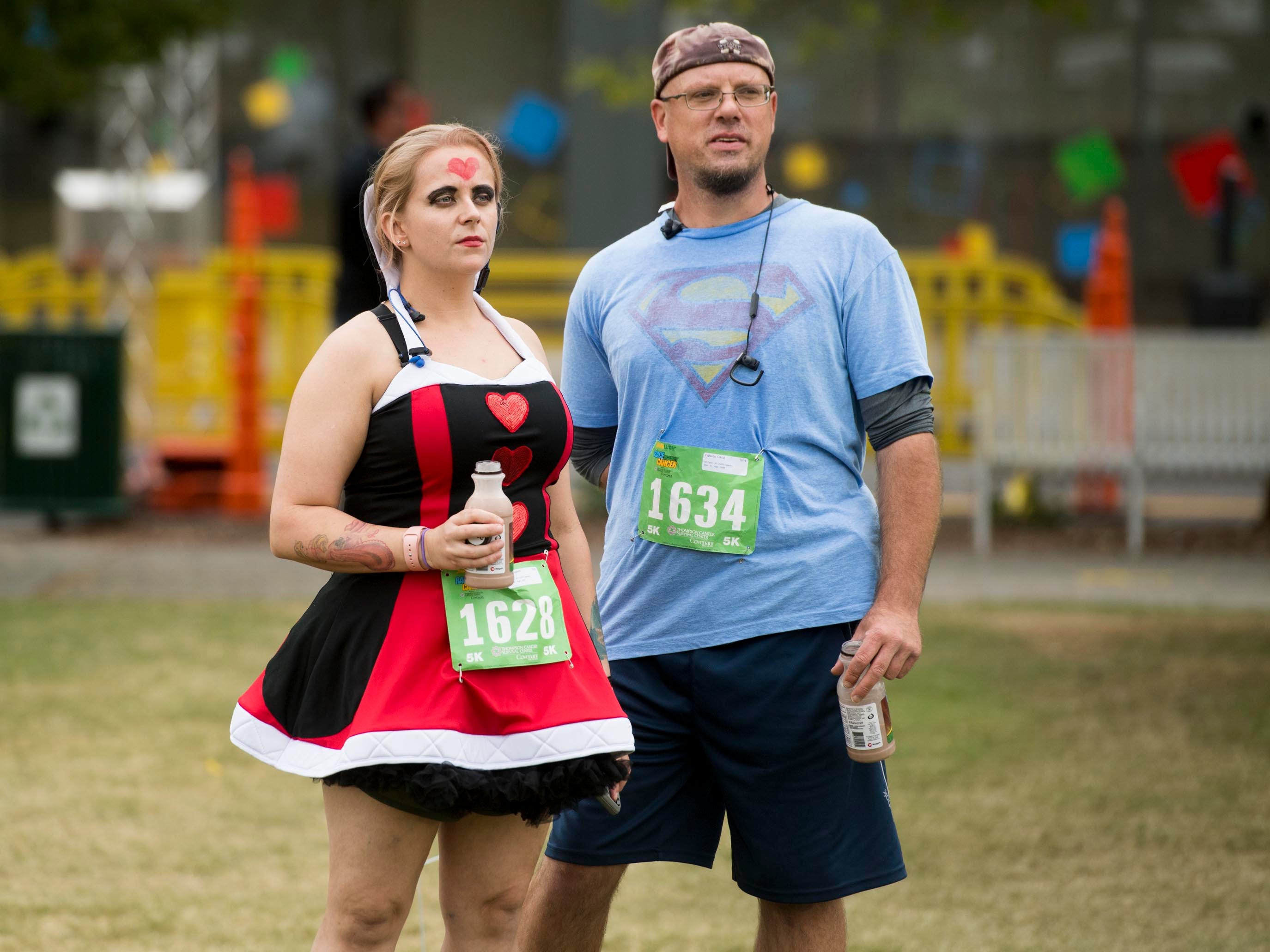Elisabeth Carr and David Oglesby wait for the start of Covenant Health's Subway Race Against Cancer at World's Fair Park on Sunday, October 14, 2018. Carr is running as the Queen of Hearts for her papaw Myrl Carr.