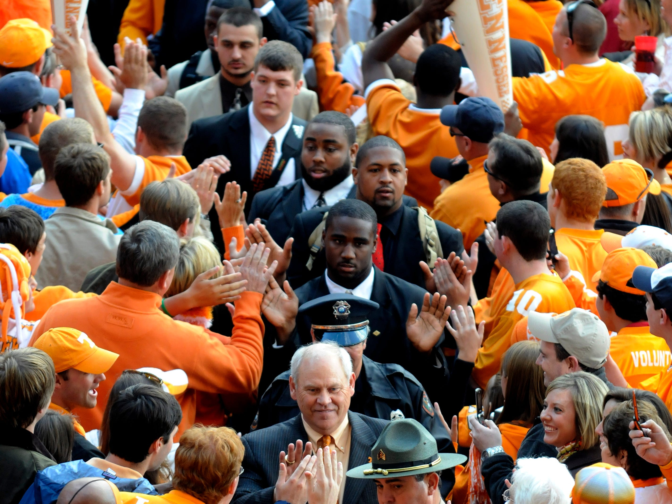 Tennessee Volunteer Head Coach Phillip Fulmer walks through cheering fans during the Vol Walk two hours before their battle with the Crimson Tide of Alabama, Saturday, October 25, 2008 in Neyland Stadium.