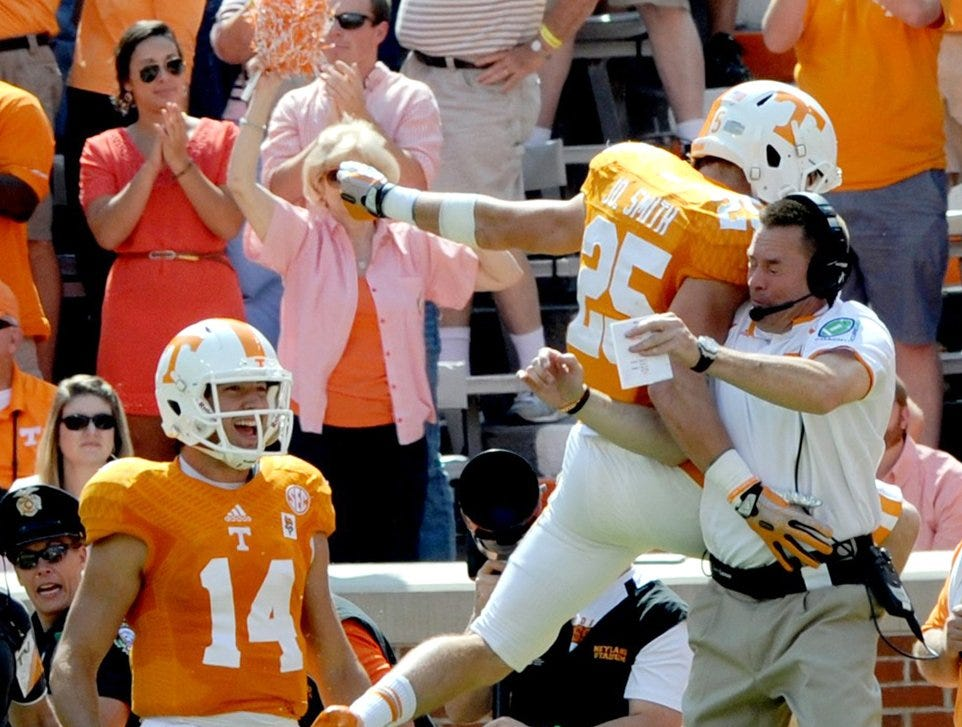 Tennessee wide receiver Josh Smith (25) celebrates with Butch Jones following his 29-yard touchdown in the first half against South Alabama  Saturday, Sep. 28, 2013 at Neyland Stadium in Knoxville.