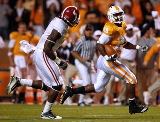 Tennessee's Tauren Poole (28) outruns Alabama's Mark Barron (4) for a touchdown during a NCAA college football game Saturday, Oct. 23, 2010 at Neyland Stadium in Knoxville, Tenn.