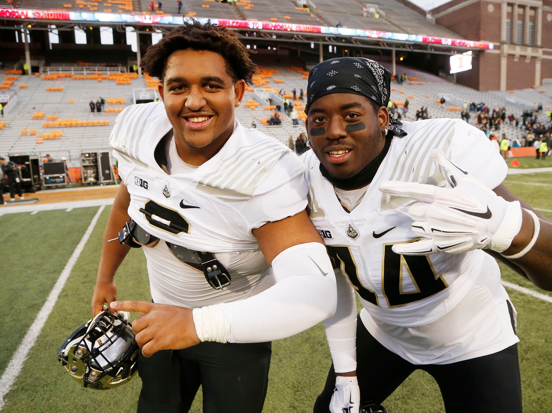 Lorenzo Neal, left, and Anthony Watts mug for cameras after Purdue defeated Illinois 46-7 Saturday, October 13, 2018, in Champaign, Illinois.